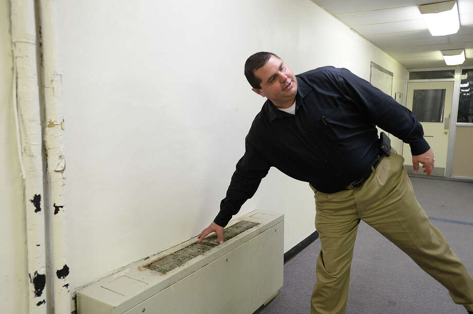 Sections of the Hardin County Courthouse annex building have been closed off due to a mold problem, according to judge elect Wayne McDaniel, who gave a tour of the affected areas to The Beaumont Enterprise Monday. The closure of the WIC and crime victim's offices came on the heels of a recommendation by Southeast Texas Environmental, Inc., who found elevated levels of mold in the offices following an investigation of the site. The issue has caused the county to seek architectural bids for a new building to house its annex offices, which includes the county health department, senior services and WIC program.  Photo taken Monday, December 22, 2014 Kim Brent/The Enterprise Photo: KIM BRENT / Beaumont Enterprise