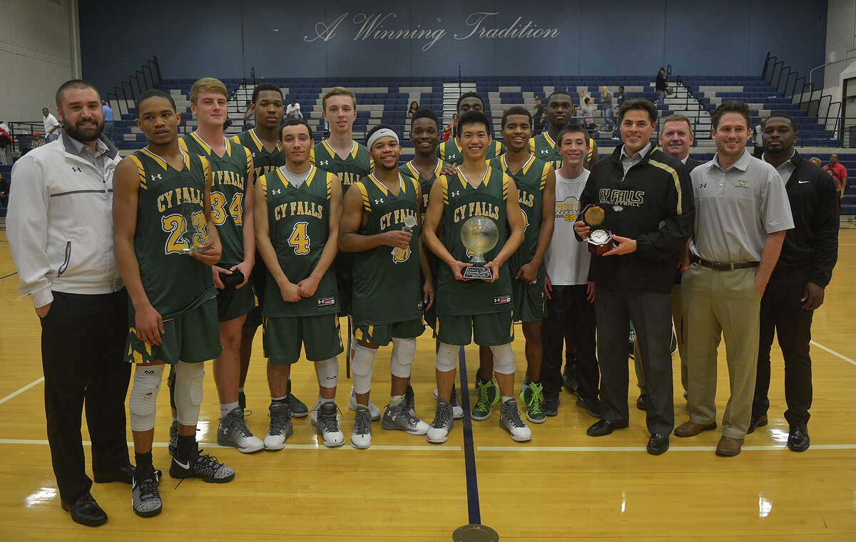 The Cy Falls Golden Eagles gather for a team photo following the 70-55 win over Yates in the Kingwood Insperity Holiday Classic Wednesday. The Eagles won four consecutive contests in two days, against Austin Anderson, Cy-Fair, Lamar and Yates, to earn the tournament title.