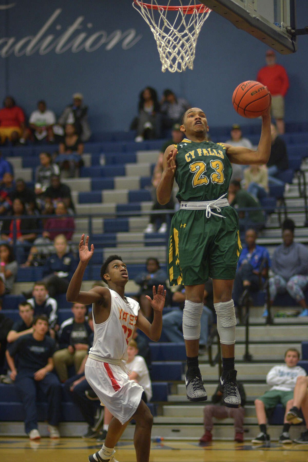 Cy Falls junior guard Nigel Hawkins delivers a raucous slam in Wednesday's matchup against Yates. Hawkins was named the All-Tournament MVP and was a vital factor in all four of the Eagles' tournament wins.
