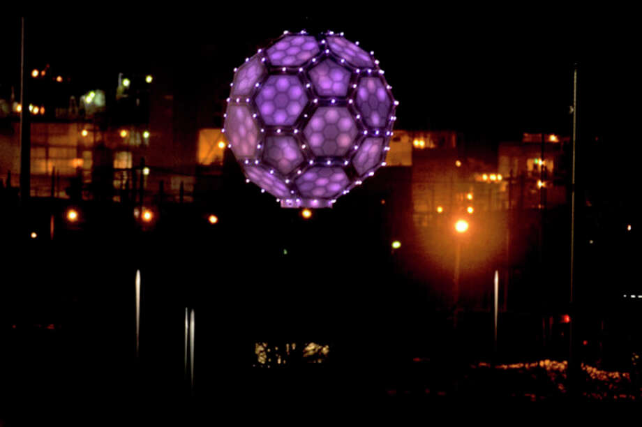 The ball drops as the clock strikes midnight during last year's Midnight on Main celebration at Dow Diamond. / Midland Daily News