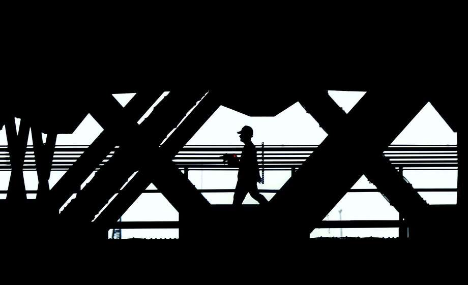 FILE: A worker is framed along the Walk Bridge in Norwalk. Photo: Erik Trautmann / Hearst Connecticut Media / (C)2016, The Connecicut Post, all rights reserved