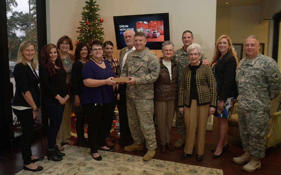 Representatives from RE/MAX The Woodlands & Spring presented gift cards to representatives from Conroe's U.S. Army Reserve Unit, First Battalion, 158th Aviation Regiment, for distribution to soldiers in need. Taking part were, from left, Mindy Wakefield, Candice Cavin, Vanissa Micklethwait, Christine Hale, Danna Furnace-Grimes, Kassandra Bissett, Patrick Ireland, Lt. Col. Ed Naughton, Cissy Baylor, Chief Warrant Officer 4 Justin Dudley, Sandra Pillow, Jacci Kilgore and Command Sgt. Maj. Eric Dorsch at RE/MAX The Woodlands & Spring. Photo: Courtesy Of Courtesy Of RE/MAX The Woodlands & Spring