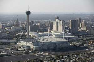 A janitorial services contractor and one of his former employees are accused of fraudulently overbilling the city $500,000 for cleaning the Alamodome.