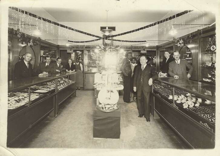 The Wexler Jewelry staff is ready to serve customers in 1941 at its original location downtown.Founder James Wexler is in the center part  of the store.