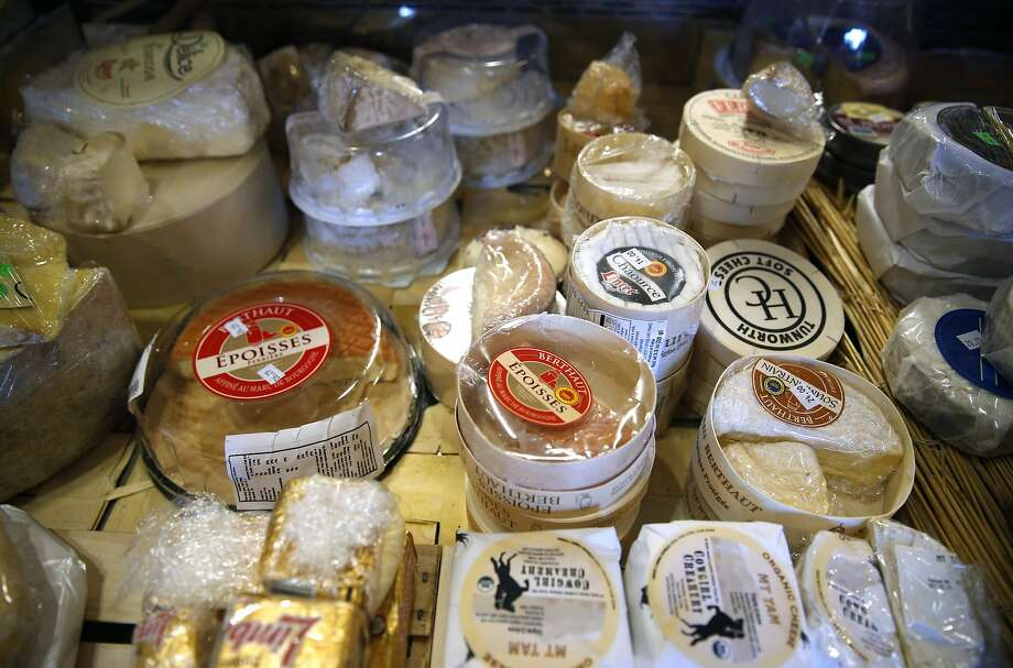 "A selection of cheeses displayed at the Cheese Board Collective in Berkeley. Nina Teicholz, author of ""The Big Fat Surprise,"" has concluded that saturated fats, including cheese, actually leads to better health. Photo: Paul Chinn, The Chronicle"