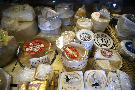 "A selection of cheeses are displayed at the Cheese Board Collective in Berkeley, Calif. on Thursday, Dec. 29, 2016. Nina Teicholz authored ""The Big Fat Surprise"" which concludes that saturated fats, including cheese, actually leads to better health, fitness and wellness."