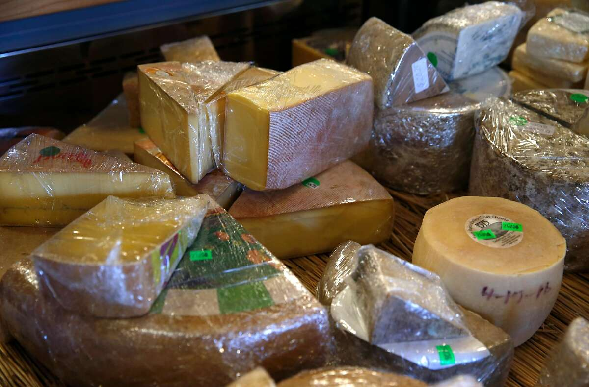 """A selection of cheeses are displayed at the Cheese Board Collective in Berkeley, Calif. on Thursday, Dec. 29, 2016. Nina Teicholz authored """"The Big Fat Surprise"""" which concludes that saturated fats, including cheese, actually leads to better health, fitness and wellness."""