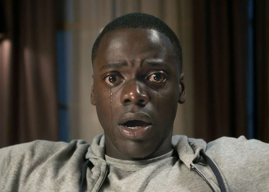 """""""Get Out""""About:Daniel Kaluuya (""""Sicario"""") plays a young African-American man who visits his white girlfriend's family estate in """"Get Out."""" Things take a sinister turn in the thrillerRelease date:February 24 Photo: Universal Pictures"""