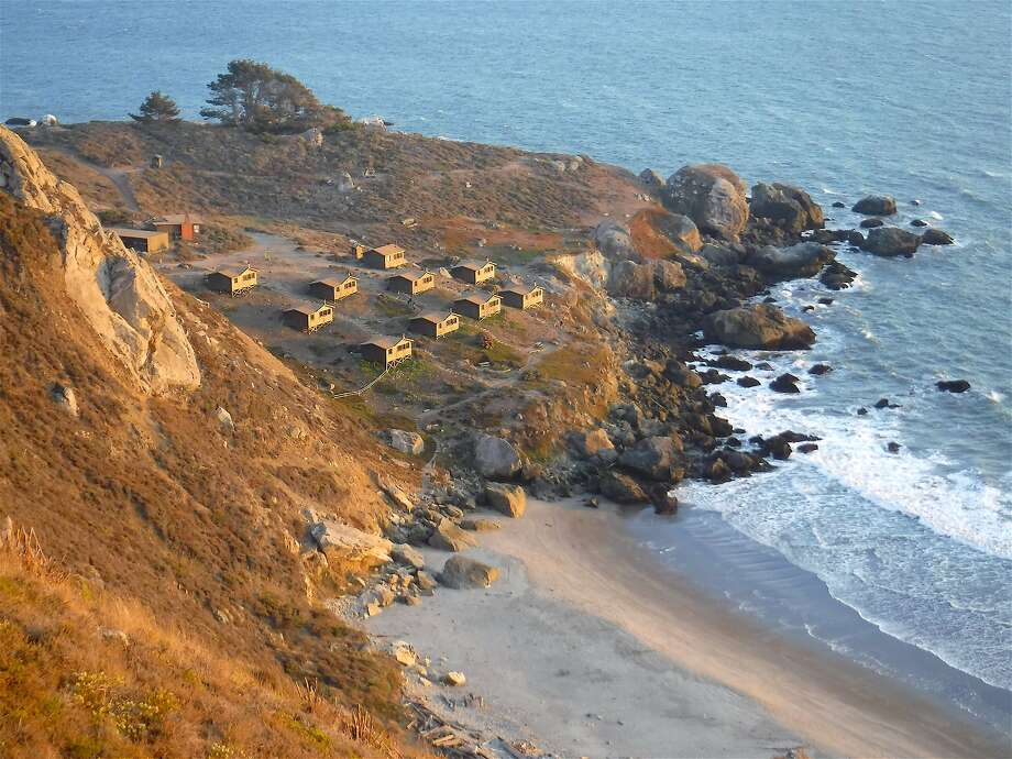 Dusk Glow Is Cast Across The Rustic Camping Cabins At Rocky Point On The  Marin Coast