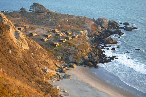 Dusk glow is cast across the rustic camping cabins at Rocky Point on the Marin coast, part of Mount Tamalpais State Park. Reservations for July go on sale at 8 a.m. Monday and are expected to sell out for the month in about 10 minutes.