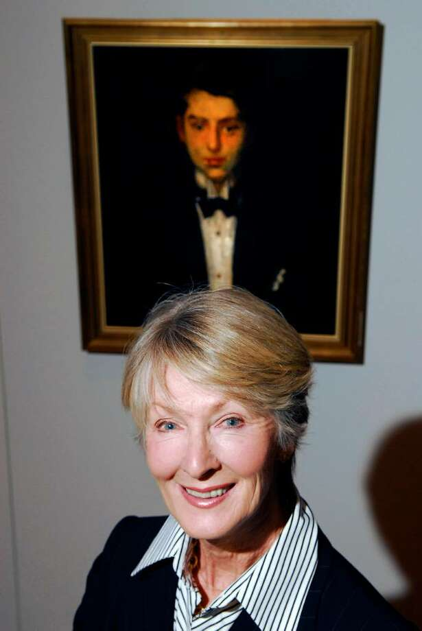 Marei Von Saher of Greenwich poses next to a painting of her father-in-law, Jacques Goudstikker, as a young man in Amsterdam done in 1916 by artist Martin Monnichendam, during a press conference at the Jewish Museum in New York City publicizing art that the Nazis seized from Goudstikker. The family has for years been recovering the looted art pieces. Von Saher now wants a Pasadena museum to return two 500-year-old paintings also part of the seized collection. Photo: File Photo / Greenwich Time File Photo