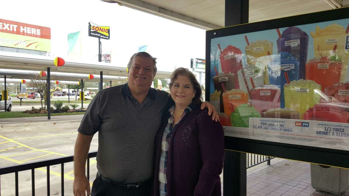 Rex Delk and Danielle Buras Bloom Delk pose for a photo outside their Sonic Drive-In location in Conroe. Having recently acquired two Sonic locations in the Humble and Atascocita areas as supervising partner, they are looking to build a relationship with the community.
