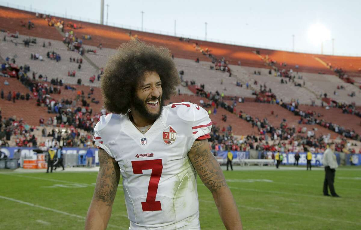 San Francisco 49ers quarterback Colin Kaepernick celebrates after their win against the Los Angeles Rams during an NFL football game Saturday, Dec. 24, 2016, in Los Angeles. The San Francisco 49ers won 22-21.