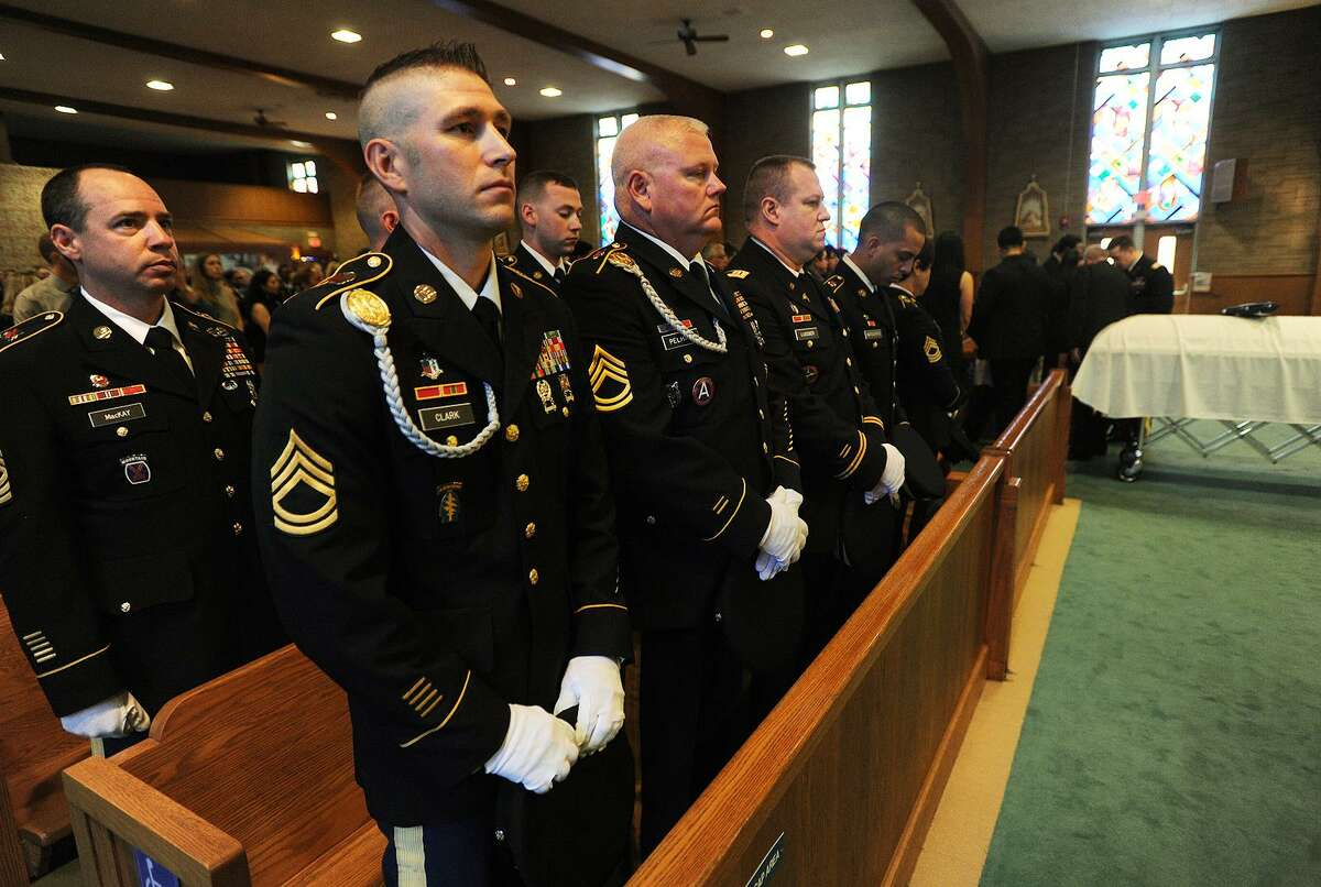 Soldiers from the 405th Combat Support Hospital, based in West Hartford, who served with Sgt. Fernando Moreno, stand during his funeral service at Holy Family Church in Fairfield .