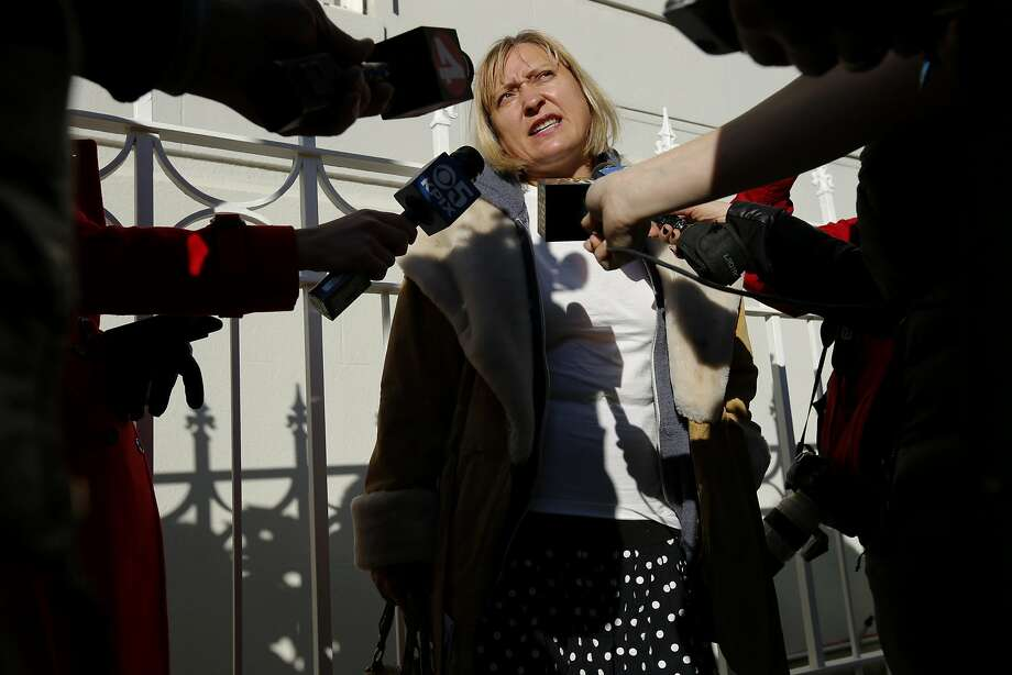 Olga Chervyakova, of San Jose, speaks to members of the news media after visiting the Consulate-General of Russia in San Francisco on Thursday, Dec. 29, 2016 in San Francisco, Calif. President Obama expelled 35 Russian nationals, including those working at the Russian Consulate in Pacific Heights, and sanctioned five Russian entities and four individuals for an alleged cyber assault on Democratic political organizations during the 2016 presidential campaign. Photo: Santiago Mejia, The Chronicle