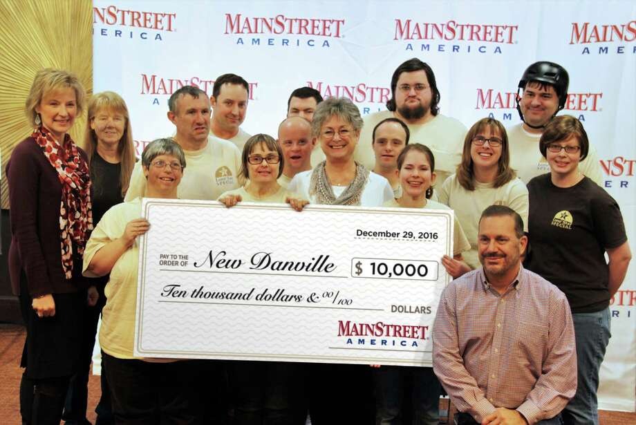 Mike and Barbara Feigin, CEO and CFO of MainStreet America, presented a $10,000 check to New Danville. New Danville won first place in the 2nd Annual Lights of Hope outdoor lighting décor competition held at MainStreet America during its holiday event, Christmas on MainStreet. Photo: Courtesy Photo