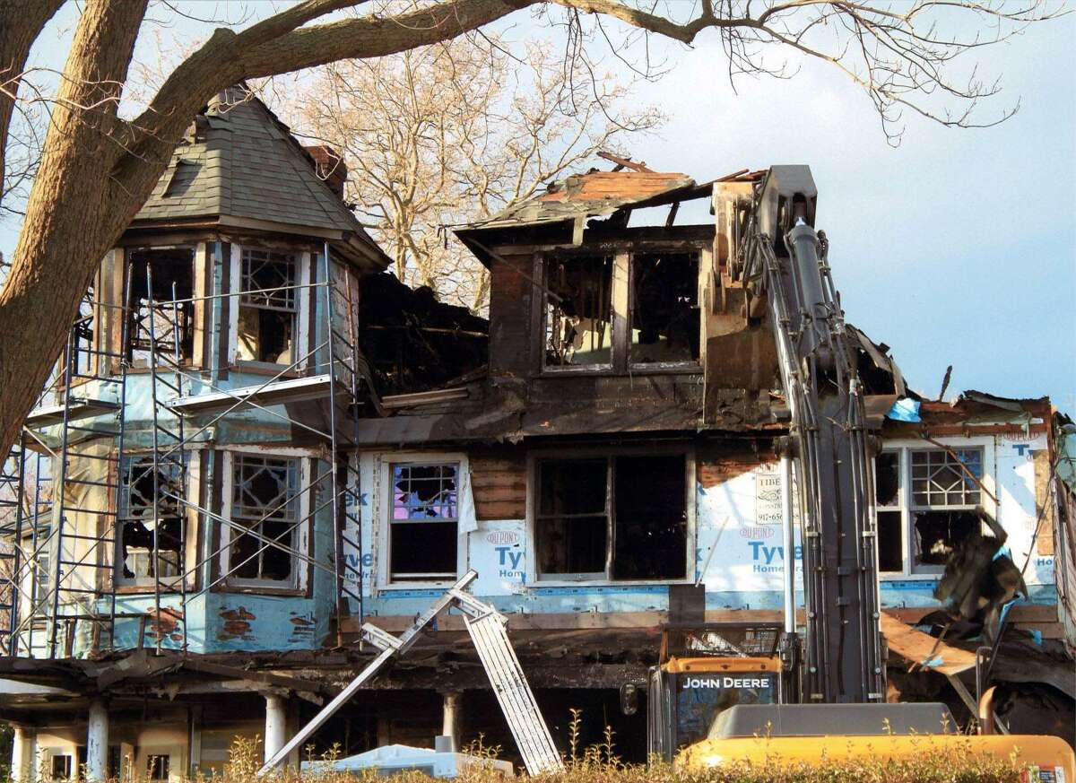The exterior of Madonna Badger's Shippan home is seen after a fire on Christmas Day, 2011, tore through the home and killed her three daughters and their grandparents.