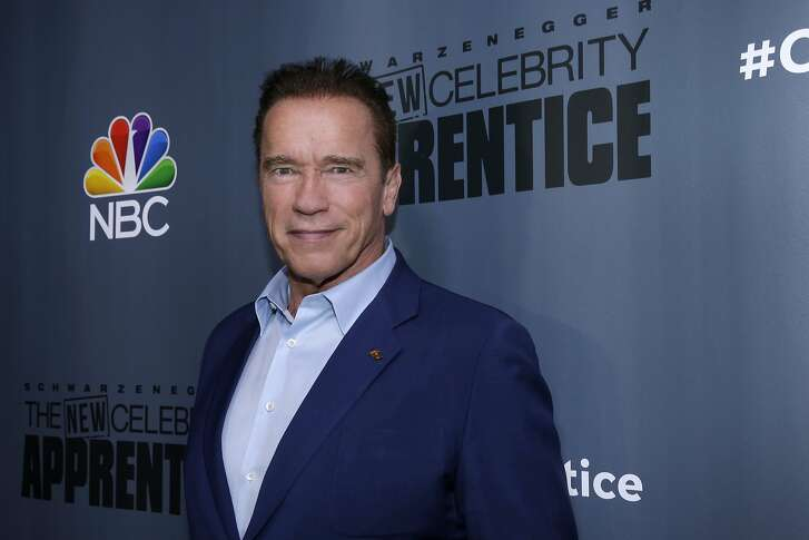 """This Dec. 9, 2016 image released by NBC shows Arnold Schwarzenegger, the new boss of """"The New Celebrity Apprentice,"""" at a press junket in Universal City, Calif. The latest season will premiere on Jan. 2, 2017. (Paul Drinkwater/NBC via AP)"""