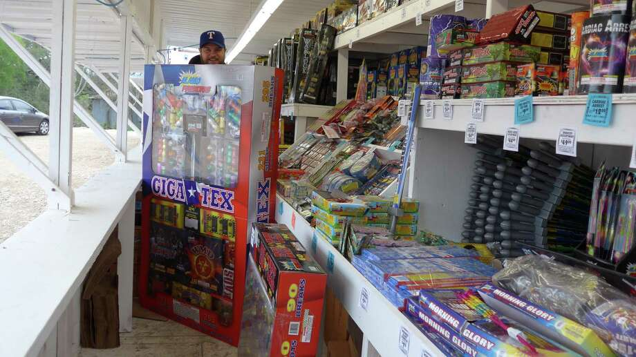 Caleb Pinyan of Denton, Texas, sells fireworks at a stand on Potranco Road just outside Loop 1604 on Tuesday Dec. 29, 2015. FILE PHOTO Photo: John W. Gonzalez /San Antonio Express-News