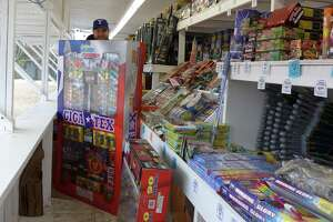 Caleb Pinyan of Denton, Texas, sells fireworks at a stand on Potranco Road just outside Loop 1604 on Tuesday Dec. 29, 2015. FILE PHOTO
