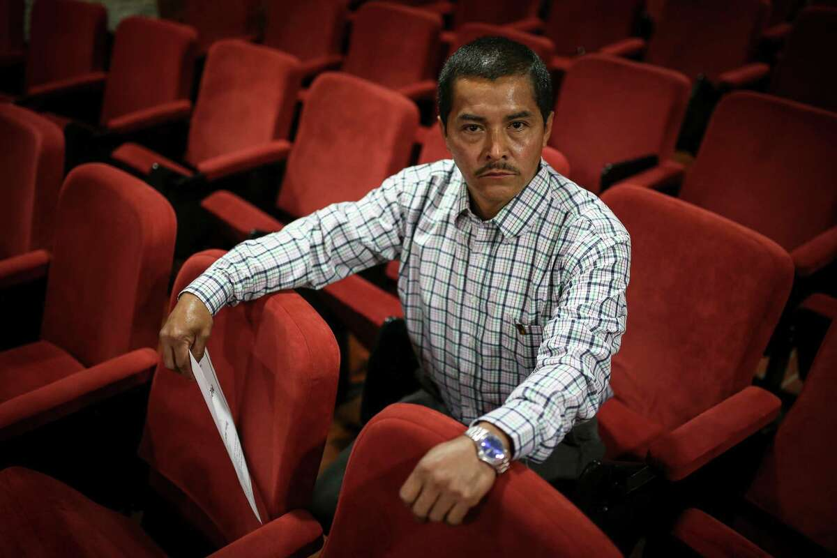 Wilson Lopez, a former  member of the rebel group FARC,  sits at a distance learning institution in Bogota, Colombia after receiving his elementary school diploma.