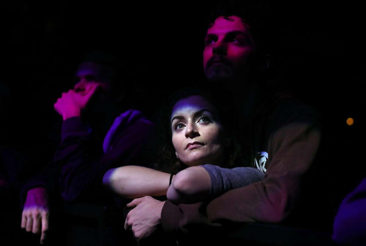 Savannah Wright and Trevor Kolsut of Pittsburg listen to Kennedy Ashlyn and Anya Taylor during Oakland United: Benefit Concert for Oakland Fire Victims at Fox Theater in Oakland, Calif., on Wednesday, December 14, 2016.