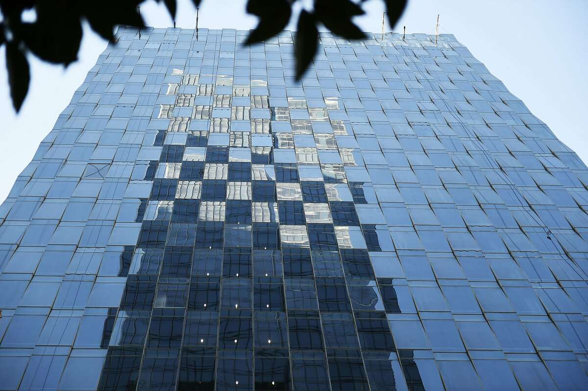 The reflection of the Millennium Tower on Friday, July 29, 2016 in San Francisco, California. The tower is currently facing structural issues causing a lean.
