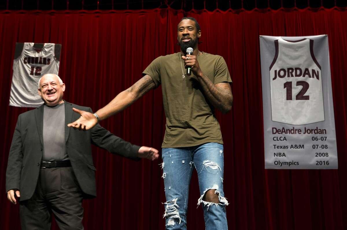 Los Angeles Clippers center DeAndre Jordan speaks after Pastor Richard Rodriguez, left, retired Jordan's Christian Life Center Academy high school basketball jersey on Thursday, Dec. 29, 2016, in Kingwood. ( Brett Coomer / Houston Chronicle )