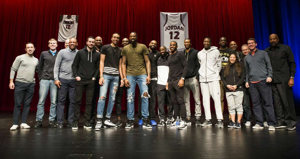 Los Angeles Clippers center DeAndre Jordan stands on stage with his Clippers teammate following a ceremony retiring Jordan's Christian Life Center Academy basketball jersey was retired on Thursday, Dec. 29, 2016, in Kingwood. ( Brett Coomer / Houston Chronicle )