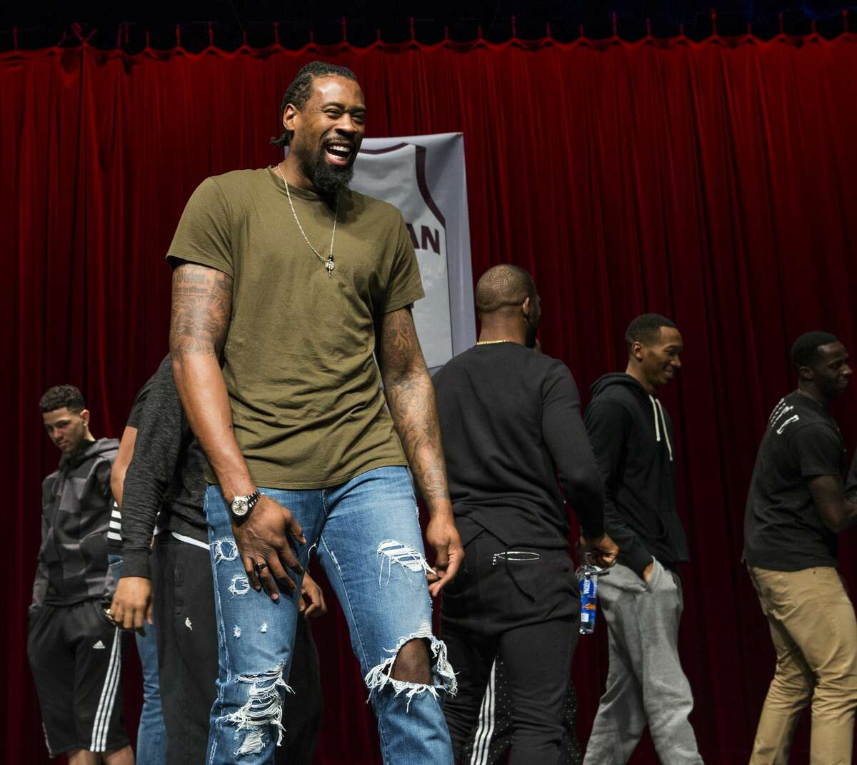 Los Angeles Clippers center DeAndre Jordan laughs as he stands on stage following a ceremony retiring his Christian Life Center Academy basketball jersey was retired on Thursday, Dec. 29, 2016, in Kingwood. ( Brett Coomer / Houston Chronicle )