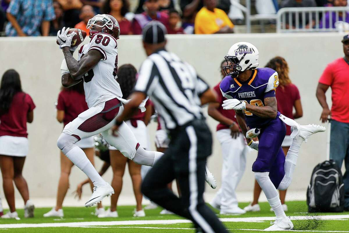 Texas Southern receiver Derrick Griffin, left, makes a touchdown catch against Prairie View on Sept. 4. Griffin was dismissed from the team later that month for breaking team rules.