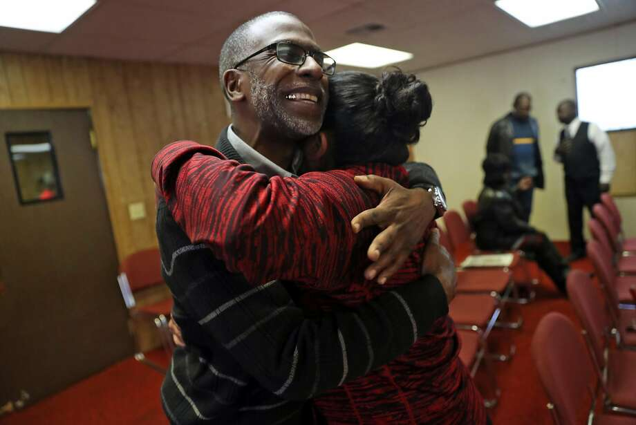West Side Missionary Pastor Ken Chambers hugs Alma Perez after church service. Photo: Scott Strazzante, The Chronicle