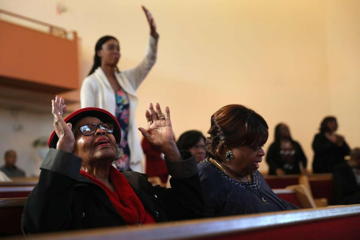 Aida Carpenter (left) during church service at Beth Eden Baptist Church in Oakland, Calif., on Sunday, November 27, 2016.