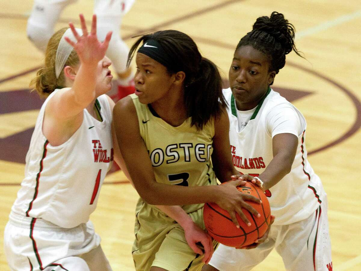 Foster guard Micayla Hamilton (3) is double teamed by The Woodlands forward Emma Warnsman (14) and guard Miima Mpagi (25) during the fourth quarter of a high school girls basketball game at the Magnolia Holiday Hoop Fest Thursday, Dec. 29, 2016, in Magnolia. The Woodlands defeated Foster 60-37 in the semifinals of the golf bracket to advance to FridayÂ?'s final at noon.