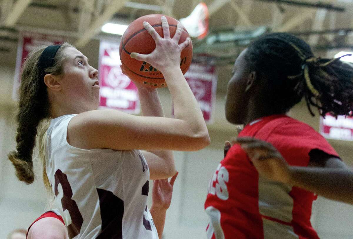 Magnolia center Katie Dalton (33) shoots over Cypress Lake guard Kelsie Griffith (30) during the first quarter of a high school girls basketball game at the Magnolia Holiday Hoop Fest Thursday, Dec. 29, 2016, in Magnolia. Magnolia defeated Cypress Lakes 58-45 in the semifinals of the golf bracket to advance to Fridayé?•s final at noon.