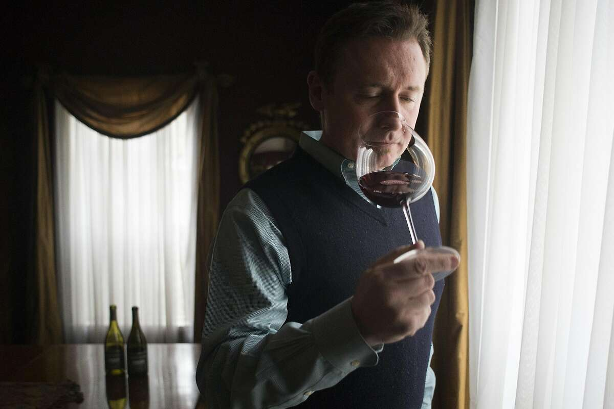 A group of vintners meet at the Forestville home of Trombetta Family Wines owner, Rickey Trombetta Stancliff, to taste wines from what is expected to be announced as a new American Viticultural Area in Sonoma County, named the Petaluma Gap on Dec. 15, 2016. Christopher O'Gorman, of Rodney Strong Wines.