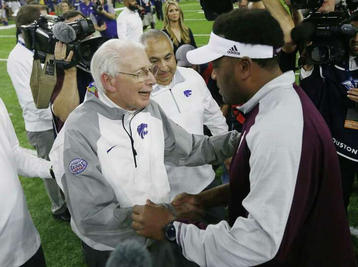 Kansas State head coach Bill Snyder and Texas A&M head coach Kevin Sumlin meet at midfield after the Texas Bowl at NRG Stadium in Houston on Wednesday, Dec. 28, 2016. (Bo Rader/Wichita Eagle/TNS)