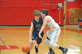 Father McGivney freshman Kellen Weir tries to get past a Ramsey defender during Thursday's seventh-place game at the Vandalia Holiday Tournament.