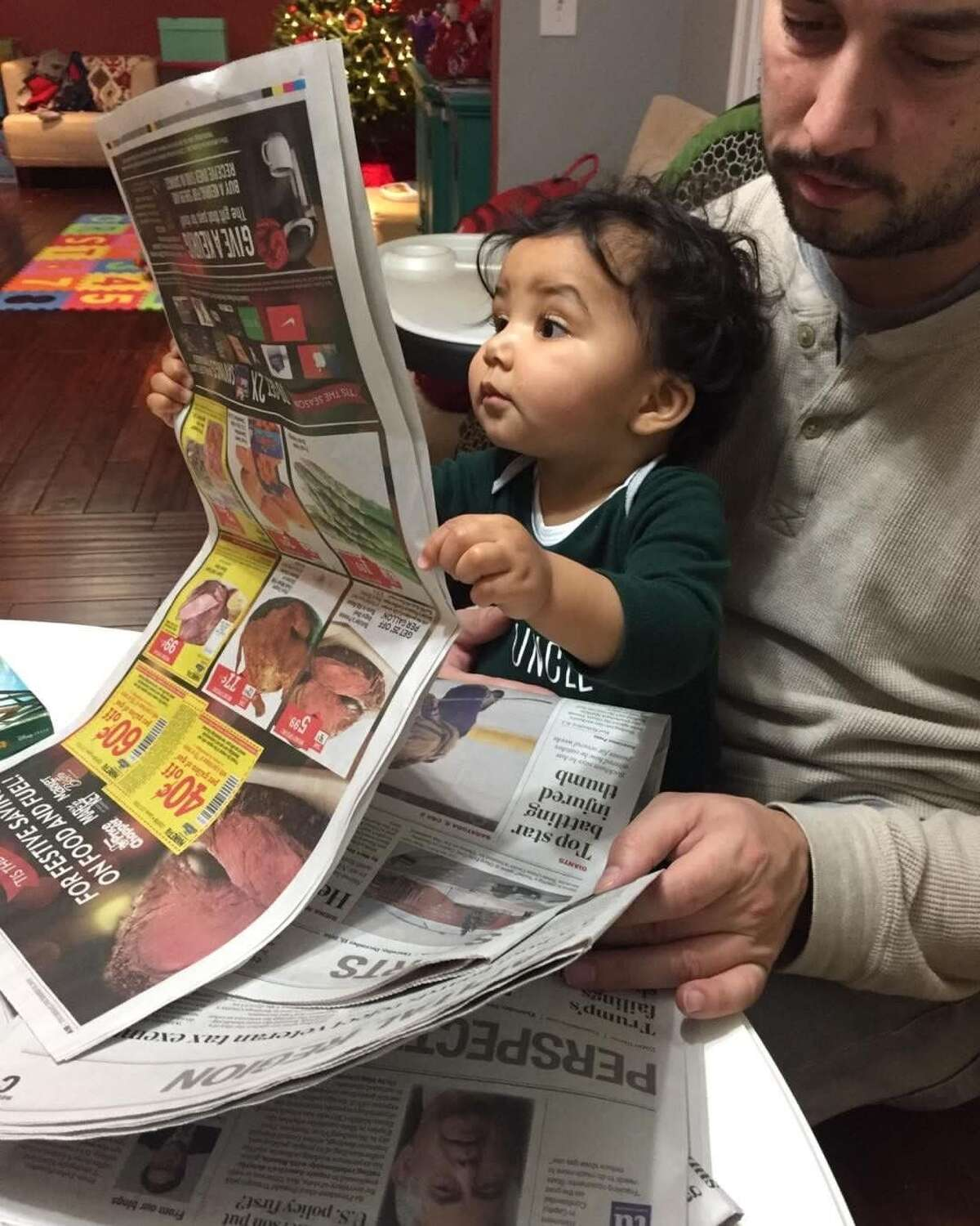 Alexander Bailey, who recently turned 1, seems quite interested in the Times Union (even if it is upside down.) Alexander, sitting on the lap of his father Kevin Bailey, looked at the paper for quite a while, his mom Tiffany told her mother-in-law Bonnie Mariano, who passed this along to us. She also notes that the young reader raised an eyebrow during his perusal. The Baileys are from Wynantskill. (Tiffany Bailey)