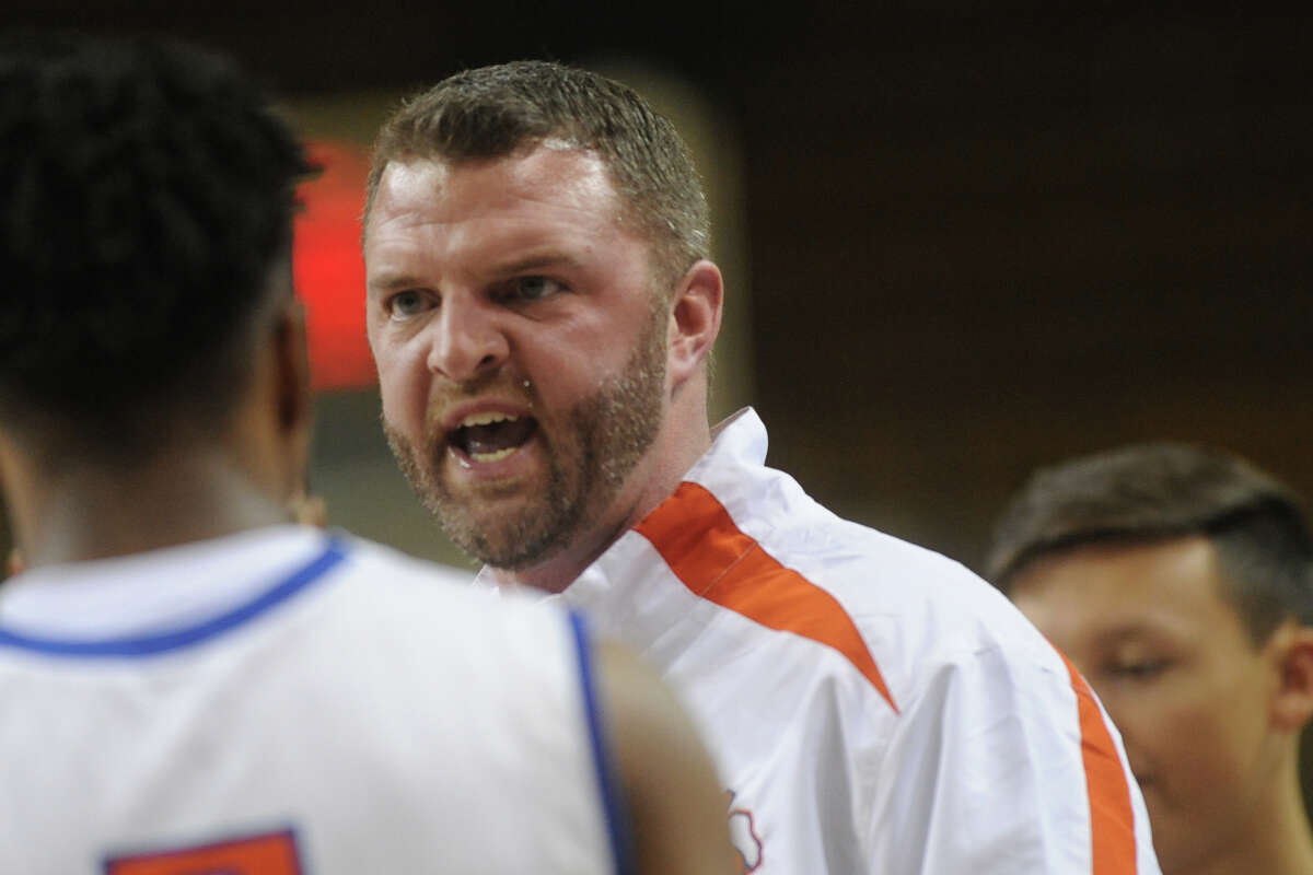 San Angelo Central boys basketball head coach Dustin Faught speaks to his team during a game against Plainview in the second day of the Byron Johnston Holiday Classic on Thursday, Dec. 29, 2016, at Chaparral Center. James Durbin/Reporter-Telegram