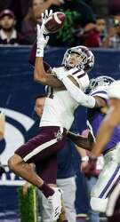 Wide receiver Josh Reynolds pulls in a 15-yard fourth-quarter TD reception in his last game for the Aggies.