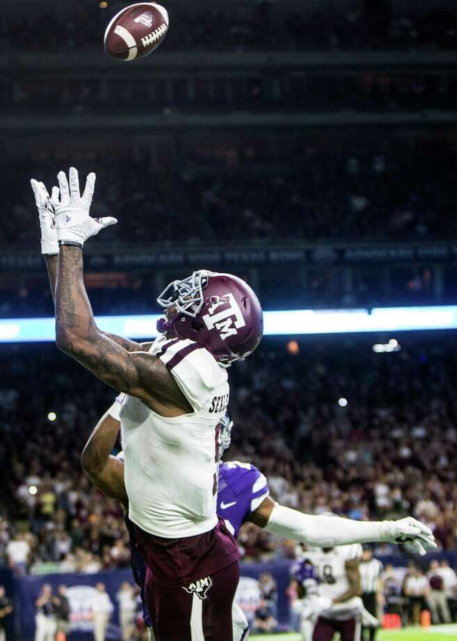 Texas A&M wide receiver Ricky Seals-Jones (9) reaches out for a 3-yard touchdown reception against Kansas State during the second quarter of the Advocare V100 Texas Bowl at NRG Stadium on Wednesday, Dec. 28, 2016, in Houston. ( Brett Coomer / Houston Chronicle ) Photo: Brett Coomer, Staff / © 2016 Houston Chronicle