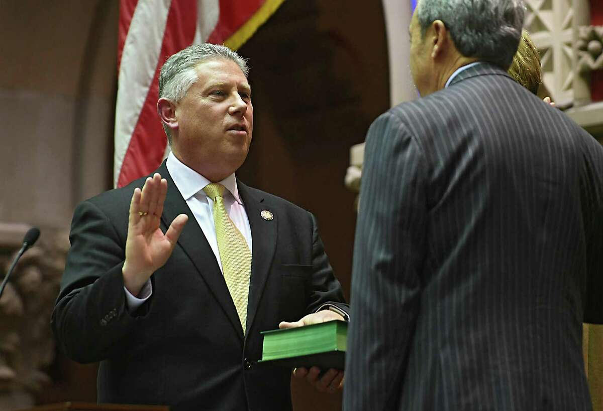 New York Assemblyman John McDonald is sworn in for another term administered by Ron Canestrari in the Assembly Chamber of the State Capitol on Thursday, Dec. 29, 2016 in Albany, N.Y.(Lori Van Buren / Times Union)