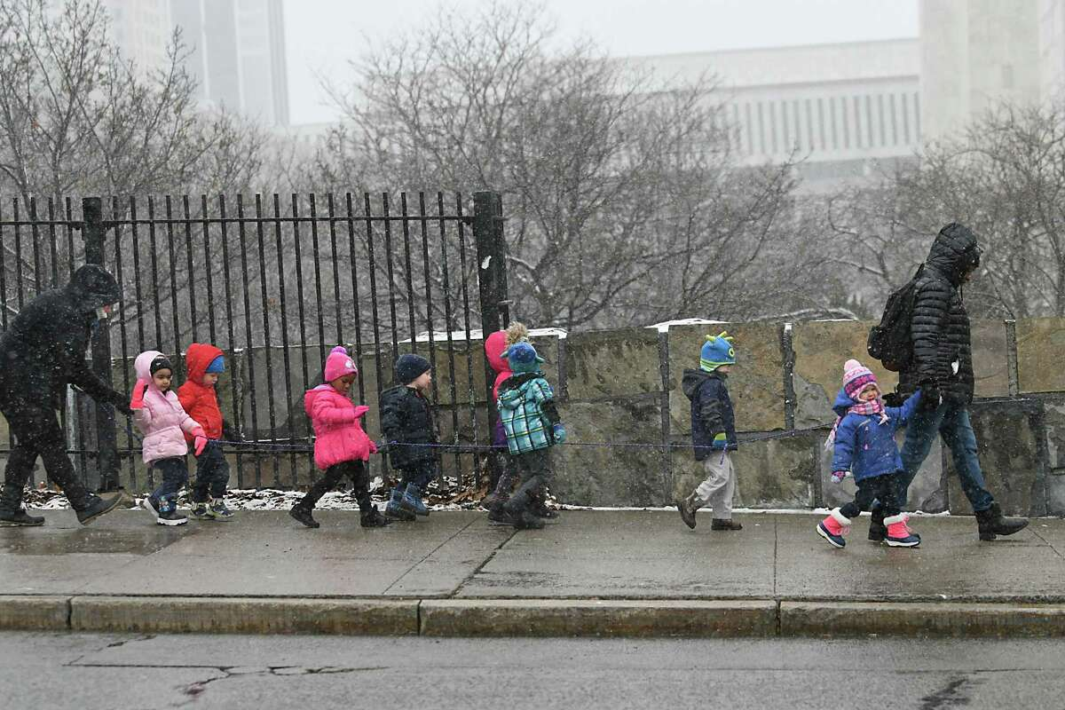 A group of pre-school children take a walk along Madison Ave. during a snow storm on Thursday, Dec. 29, 2016 in Albany, N.Y. (Lori Van Buren / Times Union)