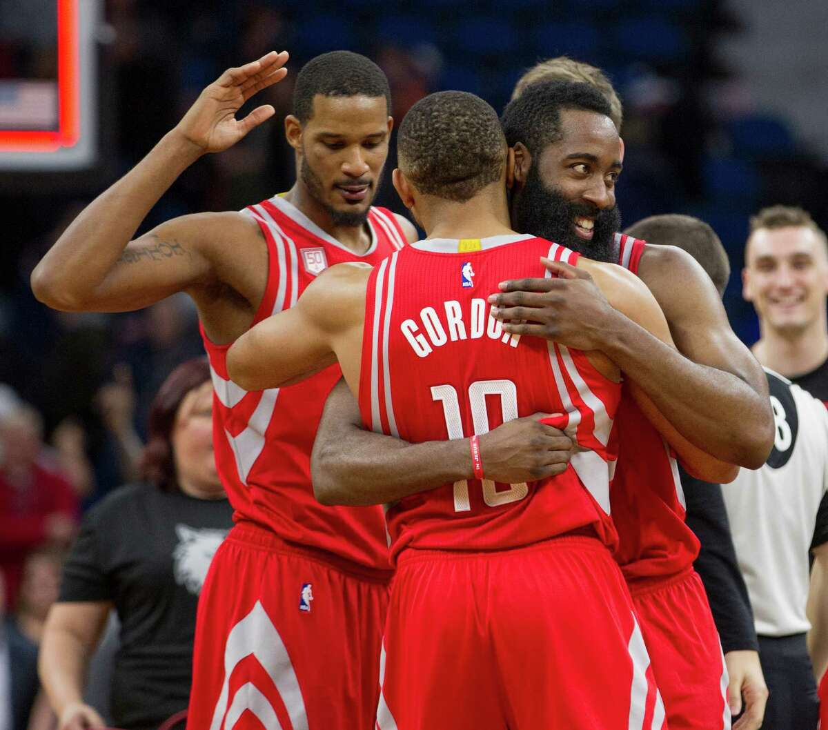 Houston Rockets guard James Harden, right, and teammates Eric Gordon (10) and Trevor Ariza, left, celebrate their 111-109 overtime win over the Minnesota Timberwolves during an NBA basketball game, Saturday, Dec. 17, 2016, in Minneapolis. (AP Photo/Paul Battaglia)