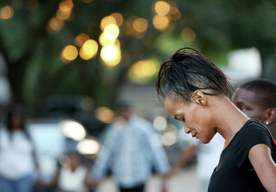 A woman prays in a circle during a united prayer outside of Casey Brown's house to seek justice for Brown Sunday, Oct. 16, 2016, in Houston. Brown is the shooting victim of an off-duty police officer over a dog dispute. Photo: Yi-Chin Lee, Houston Chronicle / © 2016  Houston Chronicle