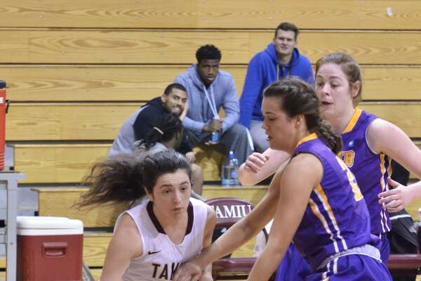 Dustdevils guard Jessica Alvarez drives to the basket while being guarded by two defenders for Mary Hardin Baylor Thursday evening at TAMIU.