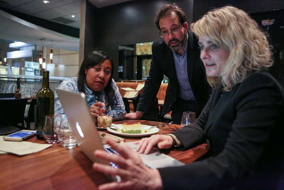 Gwyneth Borden (left), executive director of the Golden Gate Restaurant Association, talks with owners Stacy and Adam Jed at Bluestem in November. Photo: Amy Osborne, Special To The Chronicle