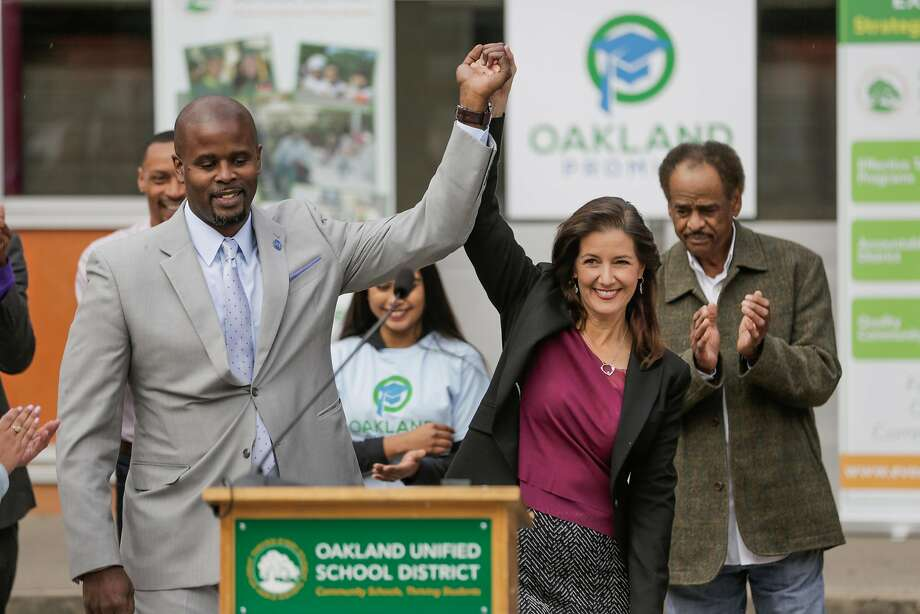 Superintendent Antwan Wilson and Mayor Libby Schaaf raise their hands in triumph at an October news conference at Oakland's Castlemont High School announcing $2 million earmarked for students to go to college. Photo: Gabrielle Lurie, The Chronicle