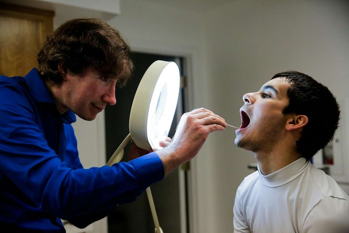 Doctor David Seftel (left), who is the doctor for jockeys at Golden Gate Fields does a routine check up with jockey and patient Ricardo Gonzalez (right) at his office, in Berkeley, California, on Thursday, Dec. 8, 2016.
